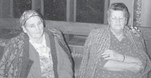 SISTERS — The late Cindy Howard and Polly Howard, who were sisters, are pictured at Cowan Community Center on Christmas in 1991. Whitesburg correspondent Oma Howard says,