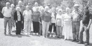 AT FISHPOND — The Ermine Senior Citizens Center recently went to Fishpond Lake. The group played horseshoes and swung on the swings. Lizzie M. Wright says,