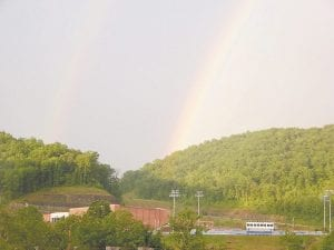 MEMORIAL DAY RAINBOWS — Twin rainbows could be seen in the sky above the campus of Letcher County Central High School at Ermine when this photo was taken about 8:15 on Monday night. (Photo by Gina Wurschmidt)