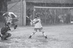 The sky opened up on the semifinal game between the Jenkins Lady Cavaliers and Powell County, causing a day and a half delay. The game, which officially began May 28, ended on May 30. Pictured here is Lady Cavalier Tazsha Hall taking her at-bat before the game was postponed. (Photo by Chris Anderson)