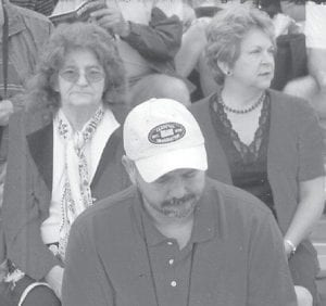 IN THE AUDIENCE for PFC Zach Day's graduation from Marine basic training at Paris Island, S.C., were his father, Randall Day, and Louise Shepherd (left) and Nanetta Dingus.