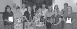 UNSUNG HEROES — The Letcher County Chamber of Commerce recently honored 14 community residents for their continuing work as volunteers. Pictured from left are (front row) Shirley Sexton, Louise Murtaugh, Creda Joyce Baker Isaacs, Grayson Shamarra Holbrook, Jim Scott, Janet Madden, Martha Watts, (back row) David Little, Jim Murtaugh, Jackie Joseph, David Perry, Madonna Sturgill and Ellen Wright. Not pictured is Todd DePriest.