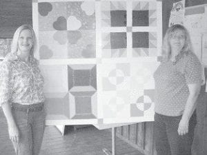 QUILT SQUARES painted by 'Tiny' Creech (right) and her daughter, Yolanda Miranda, will be installed at the Eolia Christian Community Outreach facility.