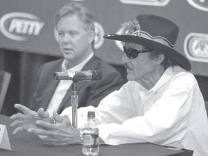 Richard Petty, right, spoke as NASCAR CEO Brian France, left, looked on during a news conference in this file photo. Even The King has been caught off guard by the severity of the recession that has caused NASCAR to tap its brakes: Automakers are entering Chapter 11 bankruptcy protection, team sponsors are slashing budgets and fans are struggling to scrape up the money to attend races.
