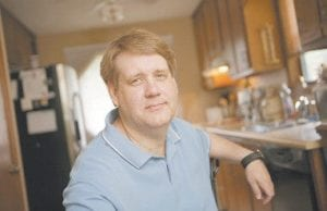 Mark Milota is dealing with unemployment at his Marietta, Ga., home and is no longer eligible for food stamps because of the $25 stimulus increase in unemployment benefits which began in March. (AP Photo)