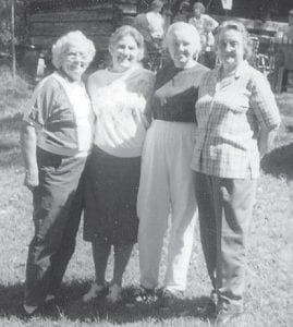 FRIENDS — These four old friends started first grade together at Blackey a few years ago. Martha (Dixon) Burns, Oma (Howard) Hatton, Joann (Back) Watts, and Hope (Back) Campbell are pictured at a Elk Creek reunion at the home of Dr. Artie Ann Bates four or five years ago.