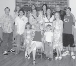 SURPRISE! — Aileen Collins of Taylor, Mich., formerly of Letcher County, was the guest of honor at a surprise party celebrating her 80th birthday recently. She is pictured with some of her grandchildren and great-grandchildren.