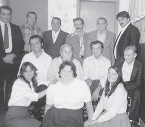 FAMILY PORTRAIT — This photo of the family of the late Less and Polly Howard was made at their father's funeral in the early '90s. Pictured are (back row, left to right) Leonard, Melvin, Dexter, Lee, Kern, Fred, (middle row) Garland, their mother Polly, Bob, Ken, (front row) Mary Lou, Ida, and Betty Jean. Wanda (Tyree) Stidham wanted to see a picture of this family.