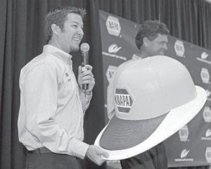 CHANGE IS COMING — Martin Truex Jr., left, shared a laugh with team owner Michael Waltrip, right, during a news conference in Cornelius, N.C., on Tuesday to announce Truex will drive for Michael Waltrip Racing. (AP )