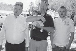 FOUR GENERATIONS — Four generations of the Anderson family were photographed recently. Pictured are Earnest Andrew Anderson of Craft's Colly, David Andrew Anderson of Jenkins holding two-month-old Hunter Andrew Anderson, and Jason Andrew Anderson of Beefhide.