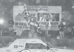 THE STOCK 4 FEATURE winner at Mountain Motor Speedway was #0 Roger Burke. (Photo by Jodie Smallwood)