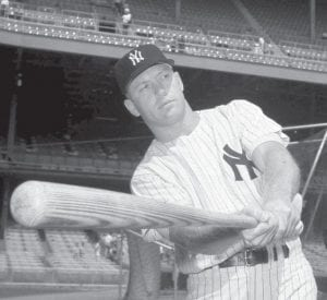 The late Mickey Mantle took a pre-game swing for the benefit of photographers at Yankee Stadium in 1961. Mantle's mammoth swing and country-boy charm made him a larger-than-life hero to generations of fans. With attendance down this season, baseball is in bad need of players who had the lure of Mantle. (AP photo)