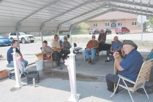 BOAR'S NEST — The old A&P parking lot has become a popular gathering spot for retired men in Letcher County. Elbert Lee, of Whitesburg, said sometimes by the end of a day about 100 people will have stopped by to sit and talk under a carport located on a corner of a parking lot in front of the old A&P building in Whitesburg. Members of the Boar's Nest include Gary Fields, Robert Amburgey, Dewey Bradley, Hobert Sergent, Terry Richardson, Elbert Lee, Clarence Sexton and Bernie Johnson.