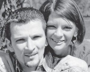 NEWLYWEDS — Kelli Lucas and Jason Pease were married July 11 at the home of the bride's parents. Whitesburg correspondent Oma Hatton says,