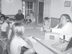 PET SNAKE — Don Billett showing Charlie, his pet garter snake, to the children at ECCO during