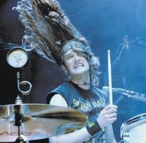 Drummer Arejay Hale (above) performs with his sister, Lzzy Hale, in the band Halestorm. Ms. Hale (seen in photo at left) is the founding member of the band, which performed in Pikeville last week.