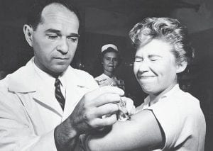 This Aug. 16, 1957 photo shows Dr. Joseph Ballinger giving Marjorie Hill, a nurse at Montefiore Hospital in New York, the first Asian flu vaccine shot to be administered in New York. U.S. health officials say swine flu could strike up to 40 percent of Americans over the next two years and as many as several hundred thousand could die if a vaccine campaign and other measures aren't successful. The infection estimates are based on a flu pandemic from 1957, which killed nearly 70,000 in the United States but was not as severe as the infamous Spanish flu pandemic of 1918-19. (AP Photo)
