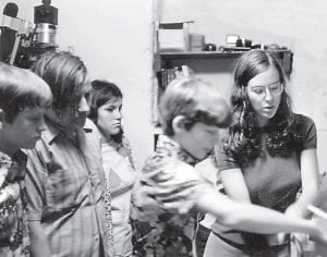 Photographer Wendy Ewald, right, was in a darkroom with some of her photography students when this photo was taken sometime before 1980. Ewald hopes to reunite with some of her former students on Saturday.