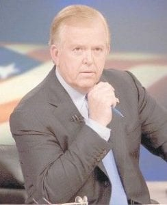 CNN's Lou Dobbs sits on the set of his show,