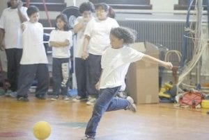 Angel Brito played kickball during physical education class at Eberhart Elementary School in Chicago earlier this year. Injuries to American children during physical education classes increased by 150 percent from 1997- 2007, a new study says. (AP Photo)