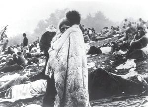 In this August 1969 file photo, which has been widely circulated, a couple shared a hug during the Woodstock Music and Art Festival in Bethel, N.Y. (AP Photo)