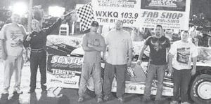 FEATURE WINNER — Greg Hampton, Clint Thomas, and driver #11 Oscar McCown celebrate their return to victory lane, leading every lap of their feature race in the Limited Late Model division at Mountain Motor Speedway.