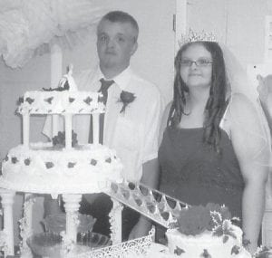 NEWLYWEDS — Jamie and Brittany Caudill were married last week. The bride is the daughter of Delana and Bobby Caudill.
