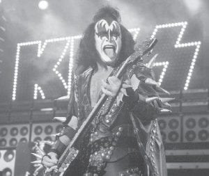 Gene Simmons, bass player for the band Kiss, performs during a 2004 appearance at the PNC Bank Arts Center in Holmdel, N.J. The heavy metal veterans are joining a growing list of classic acts putting out new music through the superstore: