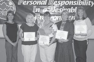 EDUCATION GRANTS — PRIDE's Tammie Wilson (left) presented certificates to Letcher County educators who were trained to comply with guidelines on behalf of the county's PRIDE grant recipients. Pictured are (left to right) Teresa Branham, Martha Jane Potter Elementary School; Darlene Campbell and Valerie Horn, West Whitesburg Elementary School; and Regina Donour, Letcher County Central High School.