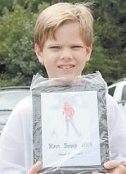 Prince Miranda, a student at Arlie Boggs Elementary School at Eolia, won the award for finding the most unusual item during the cleanup — a vacum cleaner.