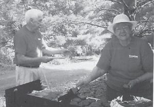 PICNICKING — Rhuford and Coleene Hart fried hamburgers and grilled hot-dogs for a picnic for the Ermine Senior Citizens Center at Fishpond Lake.