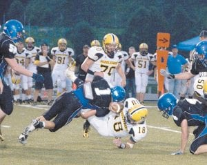 BIG HIT — Letcher County Central's Jessie Rose put a stop to a Middlesboro rushing attempt by taking down the ballcarrier with authority. (Photo by Chris Anderson)