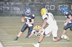 Sophomore quarterback Logan Johnson rushed for yardage against Middlesboro during Letcher Central's win over the Yellowjackets at Ermine. The Cougars are ranked No. 5 in the Class 5A poll. (Photo by Chris Anderson)