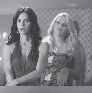 Courteney Cox, left, and Busy Philipps are shown in a scene from