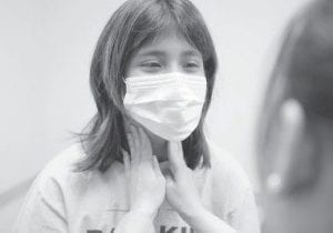 Doctors examined a Chicago girl for symptoms of the swine flu virus at Alivio Medical Center in Chicago. (AP Photo)