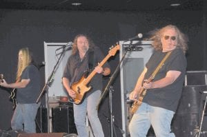 LABOR DAY JAM — Guitarist Greg Martin, lead singer Doug Phelps, and guitarist and vocalist Richard Young jammed at center stage during the Kentucky Headhunters' concert at River Park Monday evening. The group headlined the City of Whitesburg's Labor Day celebration. (Photo by Chris Anderson)