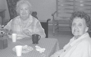 LABOR DAY PICNIC — Residents at Letcher Manor Nursing and Rehabilitation Facility celebrated Labor Day with a picnic, held indoors because of rain. The rainy weather didn't stop the resident from enjoying music, food, and the company of their family and friends. Pictured above are (left to right) Rose Dingus and Leanza Mullins.