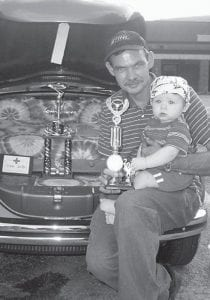 FIRST CAR SHOW — Preston Andrew Griffin recently attended his first car show. He is pictured with his grandfather Phil Griffin of Jenkins at the Brothers of the Wind car show on August 29. The Griffins entered a 1972 teal and green Volkswagen Bug that won first place in the import category.
