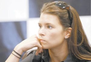 Danica Patrick, a driver in the IndyCar Series, has toured NASCAR race shops in North Carolina, and has sought advice from Chip Ganassi, who owns both IndyCar and NASCAR teams, and last week spent time with Tony Stewart, who has driver championships in both series. (AP Photo/Ed Reinke)