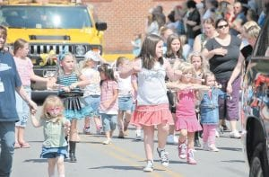 LITTLE HANNAHS — Twirlers dressed in the fashion of Disney's Hannah Montana paraded through