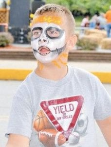 D.J. McCall had his face painted to mark the arrival of the 2009 Neon Area Days festival.
