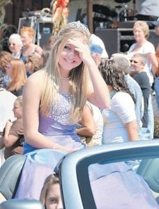 Fleming-Neon Elementary School's football homecoming queen, Chelsea Wright, shaded her eyes from the bright sun during the Neon Days Parade.