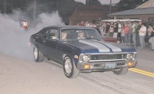 BURN-OUT CITY — Smoke and the smell of burning rubber were in the air in downtown Whitesburg on Friday nigh t as participants in the H eritage 2K9 c ar and tr uck show were allowed to do