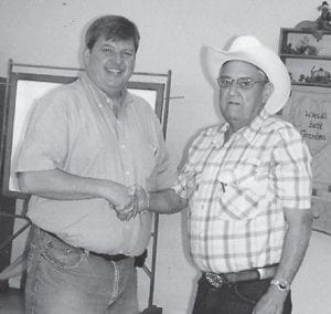 HOEDOWN — Letcher County Judge/Executive Jim Ward (left) and Lennon Hammock recently enjoyed at Wester hoedown at the Boone Fork Senior Citizens Center.