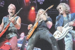 SCREAMING GUITARS — Night Ranger guitarists (from left) Brad Gillis, Joel Hoekstra and Jack Blades peformed during the band's opening slot for Journey in Pikeville last week. Gillis and Blades are original members of the band, which formed in San Francisco in the early 1980's. (Photos by Chris Anderson)
