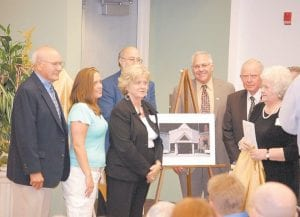 Seen in the foreground of the photo above are Dan Combs, Emily Kincer, Anna Caudill Craft, James M. Caudill Jr., and Penny Caudill Ritter Combs. The five were at the Whitesburg campus of Southeast Kentucky Community and Technical College on Sept. 23 to help mark the 20th anniversary of the school's arrival in Whitesburg. As part of the ceremony, the old Coca-Cola Bottling Co. building which serves as the centerpiece of the campus was renamed Caudill Hall in honor of the late James M. Caudill Sr., founder of the old First Security Bank (now known locally as Community Trust Bank) and former Letcher County Judge. The celebration also included a ribbon-cutting ceremony for the Belinda Mason Building; the naming of the James D. Asher Pedestrian Bridge; the naming of the Cora Reynolds Frazier Auditorium; the naming of the Mary Bingham Library, and the naming of the Hogg Allied Health Center in honor of Letcher County coal operator Maynard Hogg and his family. The late Mrs. Bingham was an owner of The Courier-Journal newspaper in Louisville and contributed heavily to the college's foundation fund before her death. The late Ms. Mason was a celebrated AIDS activist and daughter of the late Rep. Paul Mason of Whitesburg. Mrs. Frazier was a school teacher before her death, and Asher is a Whitesburg attorney who worked diligently to bring the campus to the city.