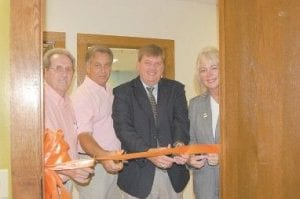 NEW ROOM AT LIBRARY — A ribbon-cutting ceremony was held on Sept. 23 for the Lula Addington Brown Technology Center at the Harry M. Caudill Library in Whitesburg. Pictured from left are Letcher County Magistrates Bob Lewis and Archie Banks, Letcher County Judge/Executive Jim Ward, and State Rep. Leslie Combs.