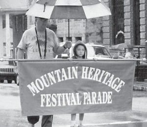 Seven-year-old Kensley Adams was chosen to carry The Mountain Heritage Festival Parade sign on Sept. 26. She is the daughter of Ryan and Jessica Adams of Jeremiah. Kensley attends Letcher Elementary School. The festival committee gave her a Mountain Heritage Festival T-shirt and a Halfway to Hazard guitar pick for carrying the banner through the parade.