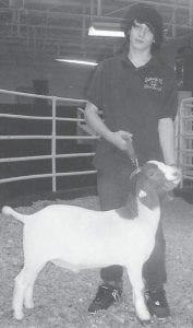 4-H AUCTION — Gerald Kessler, a member of the Garrard County 4-H Club, recently participated in the annual county 4-H livestock auction. He raised his Boer goat Chewy from a baby, and has won awards at livestock competitions throughout the state. After several minutes of hot back-and-forth bidding, Chewy sold for $700. Kessler's grandfather watched the auction and described it as very exciting. Kessler is the son of Misty Nickels Kessler and Harvey Kessler of Paint Lick. His grandparents are Jimmy Nickels of Whitesburg, Brenda Terry of Whitesburg, and John and Wanda Kessler of Hico, W.Va.