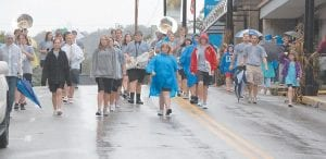 Members of the Letcher County Central High School marching band continued walking down Main Street after performing before judges in front of the Letcher County Courthouse. (Photos by Sally Barto)